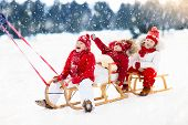 Kids On Sleigh. Children Sled. Winter Snow Fun. poster