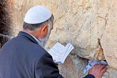 JERUSALEM, ISRAEL - APRIL 26: Jewish sitting and praying at the western wall on a jewish holiday Isr