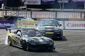 KUALA LUMPUR - MAY 20: Nattawoot (Oat) in a RX-7 car leads his team mate from the M150 Storm Team on