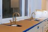 Ktchen Sinks In New Home With Sink Cabinets In New Luxury Home poster