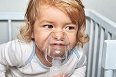 Therapy With Help Of Compressor Nebulizer For Symptom Relief For The Little White Cute Girl About 1, poster
