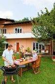 stock photo of nic  - Family having a barbecue in the garden - JPG