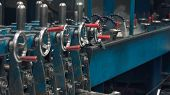 Industrial Metal Profile Forming Machine In Metalwork Factory. Workshop. Sprockets , Levers, Steel C poster