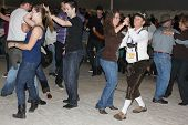 TULSA, OK - OCT 20: Party goers dance and drink beer at Oktoberfest in TULSA, OK, on October 20, 201