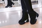 The Girl Try-on Stylish, Warm, Womens Boots Black With High Soles. Selection Of Winter Boots. poster