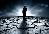 stock photo of nuclear disaster  - A depressed teenager walking towards the light - JPG