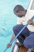 African Pool Cleaner During His Work. Cleaning Robot For Cleaning The Botton Of Swimming Pools. Auto poster