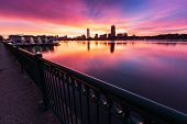 stock photo of incredible  - Image of the downtown Boston skyline backlit by an incredible winter sunrise - JPG