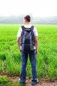 pic of knapsack  - teenager with knapsack in the summer field - JPG