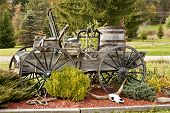 stock photo of yesteryear  - Antique wagon filled with vintage items from yesteryear - JPG