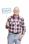 Senior Man Holding A Social Media Sign Smiling