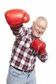 Senior Man Wearing Boxing Gloves Smiling