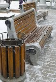 Bench and the litter-box of wooden slats in the Krasnoyarsk square in winter
