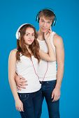 Young Love Couple. Boy Holding Girl. Wearing Headphones, Listening Music In The Studio