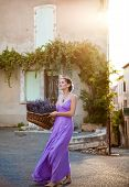image of fresh start  - Provence France. Tiny town of Sault. Girl with a basket of freshly cut lavender in the old city.