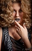 stock photo of minx  - Portrait of attractive girl with beautiful hairstyle and metallic Minx nails - JPG