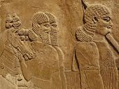 foto of babylonia  - Ancient Assyrian wall carving of men and horses - JPG