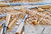 image of chisel  - Tools for working wood lying among chips - JPG