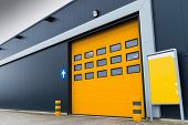 stock photo of loading dock  - yellow loading door in a storage building - JPG