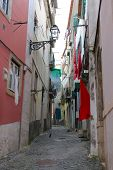 Cobblestone Alfama Street With Laundry Hanging