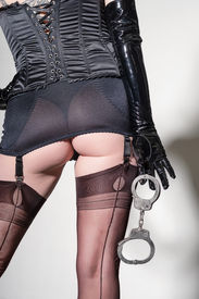image of girdles  - Closeup of dominatrix in girdle  - JPG