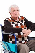 close up portrait of disabled senior man sitting on wheel chair on white background