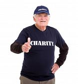 cheerful elderly charity volunteer giving thumb up on white background