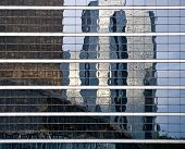 Reflection Of Modern Builds In Windows Of Office Building