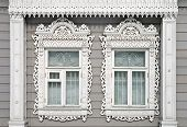 Two Carved Windows Of Old Wooden House In Historical Town Kolomna, Russia
