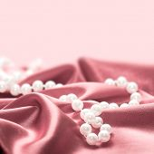Pearls On A Silk Fabric Background