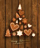 stock photo of biscuits  - Hanging Gingerbread Christmas Cookies for Xmas Decoration - JPG