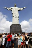 RIO DE JANEIRO - 2013: Tourists visit Christ the Redeemer, Corcovado, meaning