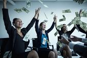 stock photo of legs air  - Business people with arms raised throwing money in air - JPG
