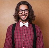 stock photo of tied hair  - Hipster guy  - JPG