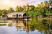 picture of alleppey  - House boat in backwaters near palms at sunrise sky in Alappuzha Kerala India - JPG