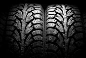 image of asymmetrical  - winter car tyre on a black background - JPG