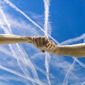 Handshake Over Beautiful Sky