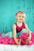 picture of tutu  - Portrait of cute little princess wearing beautiful tutu skirt on vintage wooden background - JPG