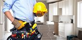 picture of construction industry  - Handyman with a tool belt - JPG