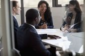 pic of dreadlocks  - Four business people sitting and discussing at business meeting - JPG