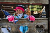 Winter, child, apres ski - young girl enjoying winter vacation