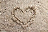 Image of heart, on sand background