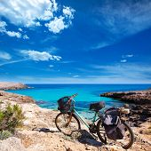 Menorca Cala des Talaier beach with aged grunge bicycle