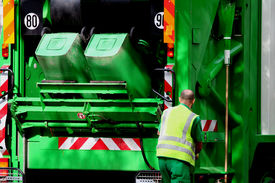 stock photo of blue-collar-worker  - garbage truck and blue collar worker - JPG