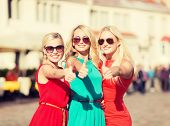 holidays and tourism, friends, hen party, blonde girls concept - three beautiful women in the city s