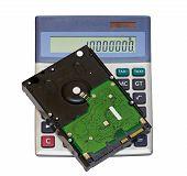 Hard disk lying on the calculator