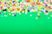 Confetti on green background