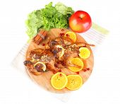 Roasted quails  on cutting board, isolated on white