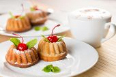 stock photo of fancy cakes  - fancy cakes dessert with cappuccino coffee on table - JPG