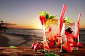 picture of mojito  - Mojito drinks on wood with evening blur ocean shore background - JPG